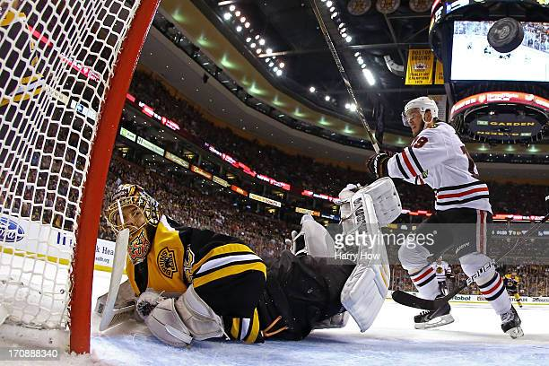 Jonathan Toews of the Chicago Blackhawks celebrates a goal by Patrick Kane in the second period against Tuukka Rask of the Boston Bruins in Game Four...