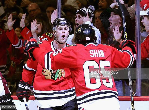 Jonathan Toews of the Chicago Blackhawks celebrates his second period goal against the Colorado Avalanche with teammate Andrew Shaw at the United...