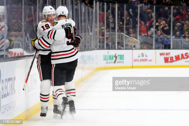 Jonathan Toews of the Chicago Blackhawks celebrates with Connor Murphy after scoring the game winning goal in overtime to defeat the Boston Bruins 43...