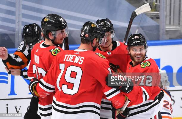 Jonathan Toews of the Chicago Blackhawks celebrates with Dominik Kubalik Kirby Dach and Alex DeBrincat after Toews scored a goal late in the first...