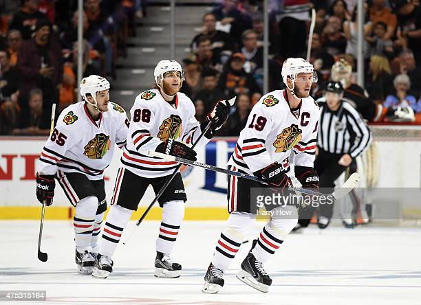 Jonathan Toews of the Chicago Blackhawks celebrates with Patrick Kane and Andrew Shaw after Toews scores his second goal in the first period against...
