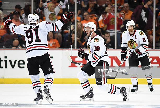 Jonathan Toews of the Chicago Blackhawks celebrates with Patrick Kane and Brad Richards after Toews scores his second goal in the first period...