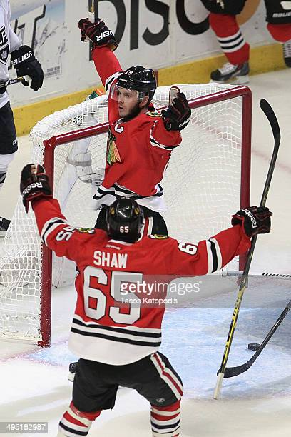Jonathan Toews of the Chicago Blackhawks celebrates with teammate Andrew Shaw after scoring a goal against Jonathan Quick of the Los Angeles Kings in...