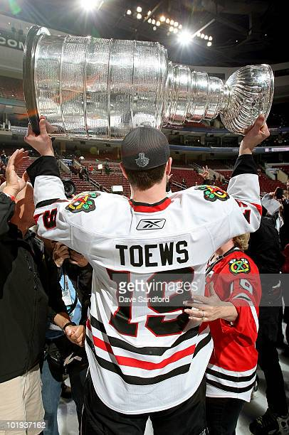 Jonathan Toews of the Chicago Blackhawks celebrates with the Stanley Cup after the Blackhawks defeated the Philadelphia Flyers 43 in overtime and win...