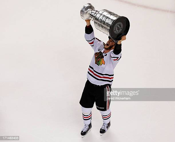 Jonathan Toews of the Chicago Blackhawks celebrates with the Stanley Cup after they won 32 against the Boston Bruins in Game Six of the 2013 NHL...