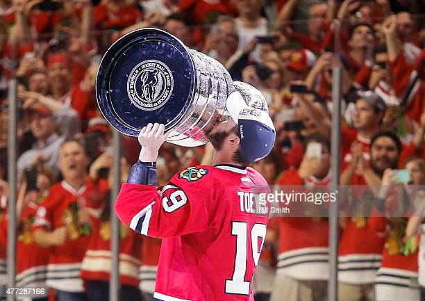Jonathan Toews of the Chicago Blackhawks celebrates with the Stanley Cup after defeating the Tampa Bay Lightning 2-0 in Game Six to win the 2015 NHL...
