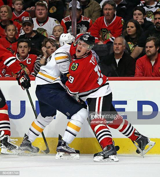Jonathan Toews of the Chicago Blackhawks collides with Evander Kane of the Buffalo Sabres at the United Center on January 8 2016 in Chicago Illinois