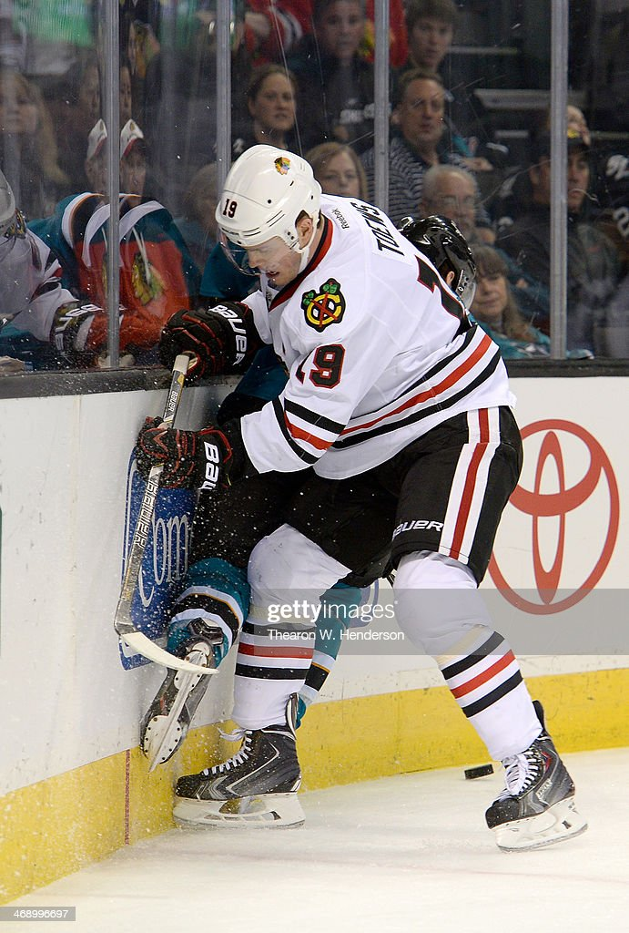 Jonathan Toews #19 of the Chicago Blackhawks collides with Justin Braun #61 of the San Jose Sharks during the first period at SAP Center on February 1, 2014 in San Jose, California.