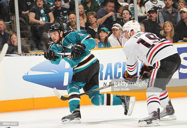 Jonathan Toews of the Chicago Blackhawks defends against Jason Demers of the San Jose Sharks in Game One of the Western Conference Finals during the...