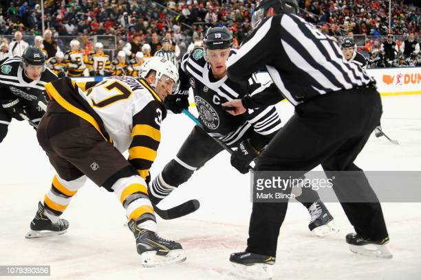 Jonathan Toews of the Chicago Blackhawks faces off against Patrice Bergeron  of the Boston Bruins during. 2019 Bridgestone NHL Winter ... 6aab8f3f4