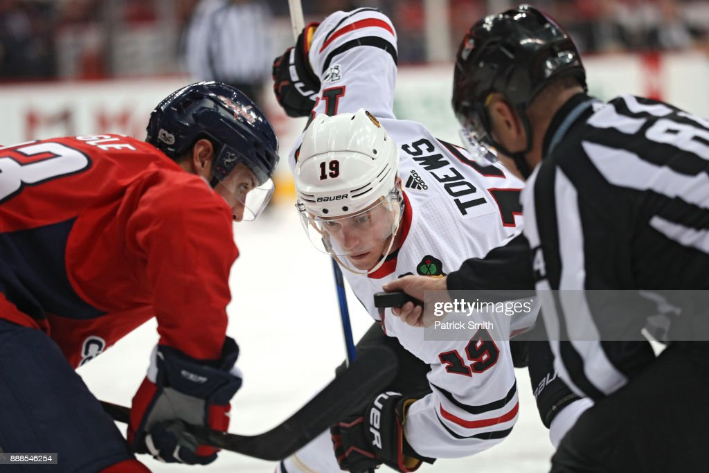 Jonathan Toews #19 of the Chicago Blackhawks faces off against the Washington Capitals during the third period at Capital One Arena on December 06, 2017 in Washington, DC.