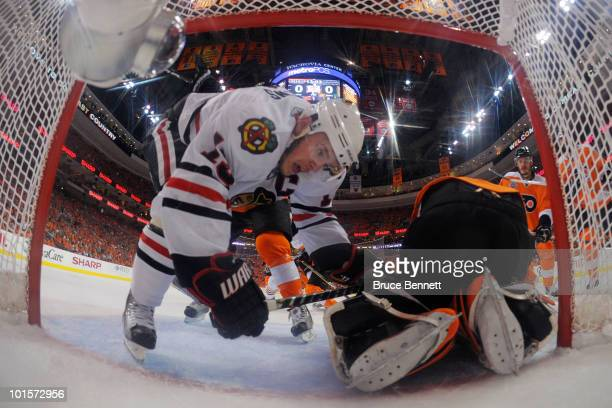 Jonathan Toews of the Chicago Blackhawks falls into the goal of Michael Leighton of the Philadelphia Flyers in Game Three of the 2010 NHL Stanley Cup...