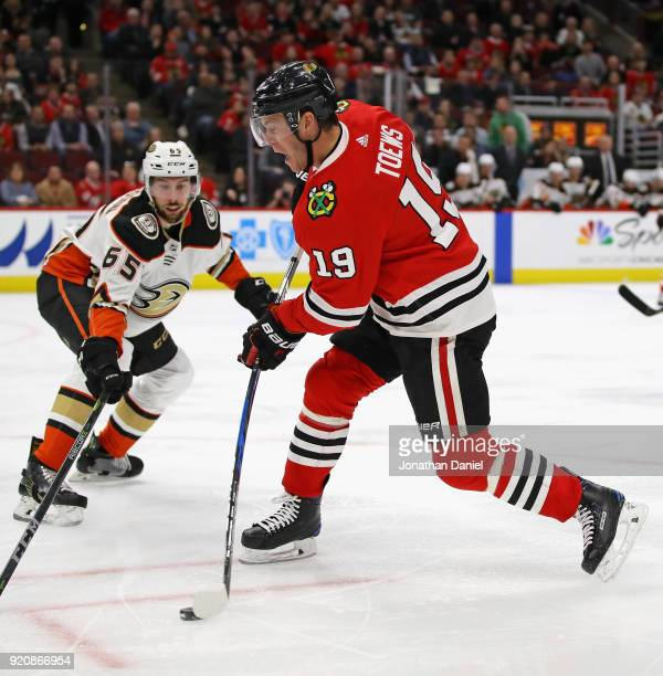 Jonathan Toews of the Chicago Blackhawks fires a shot past Marcus Pettersson of the Anaheim Ducks at the United Center on February 15 2018 in Chicago...