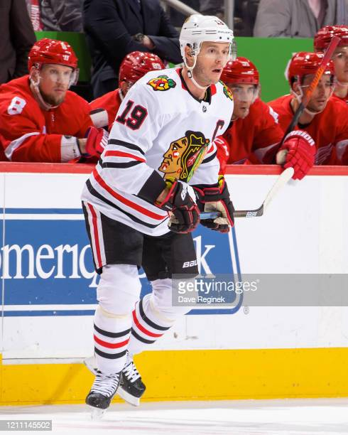 Jonathan Toews of the Chicago Blackhawks follows the play against the Detroit Red Wings during an NHL game at Little Caesars Arena on March 6 2020 in...