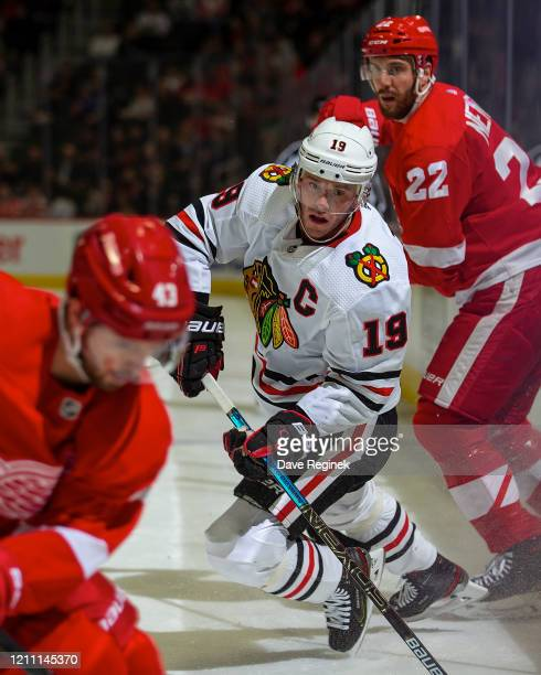 Jonathan Toews of the Chicago Blackhawks follows the play in front of Patrik Nemeth of the Detroit Red Wings during an NHL game at Little Caesars...