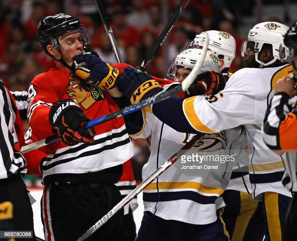Jonathan Toews of the Chicago Blackhawks gets into a skirmish with members of the Nashville Predators including Colin Wilson in Game One of the...
