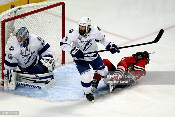 Jonathan Toews of the Chicago Blackhawks gets tangled up with Jason Garrison of the Tampa Bay Lightning in front of the net in the first period...