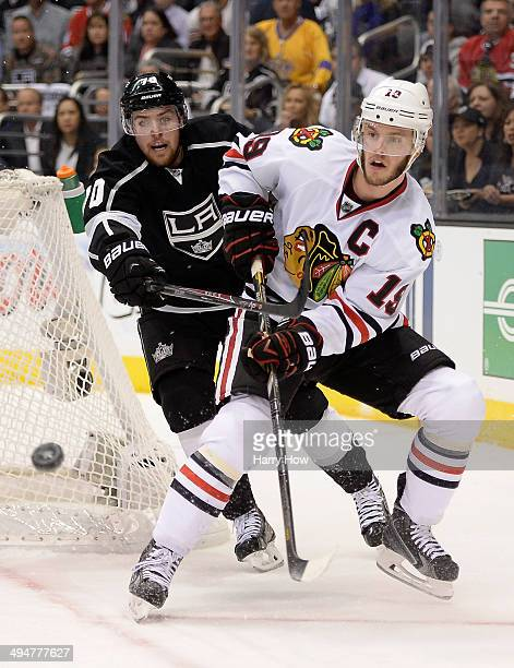 Jonathan Toews of the Chicago Blackhawks goes for the puck in front of Tanner Pearson of the Los Angeles Kings in the second period in Game Six of...