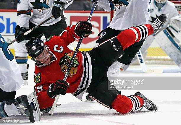 Jonathan Toews of the Chicago Blackhawks hits the ice after a faceoff with Joe Pavelski of the San Jose Sharks at the United Center on February 9...