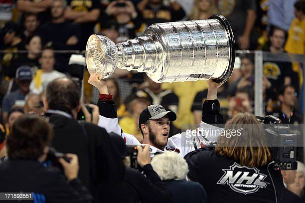 Jonathan Toews of the Chicago Blackhawks hoists the Stanley Cup after defeating the Boston Bruins in Game Six of the 2013 NHL Stanley Cup Final at TD...