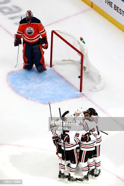 Jonathan Toews of the Chicago Blackhawks is congratulated by teammates after he scored his second goal of the game as Mike Smith of the Edmonton...