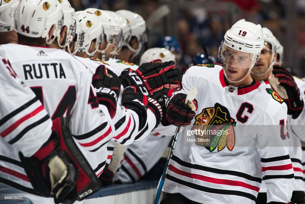 Jonathan Toews #19 of the Chicago Blackhawks is congratulated by his teammates after scoring on the Toronto Maple Leafs during the first period October 9, 2017 at the Air Canada Centre in Toronto, Ontario, Canada.