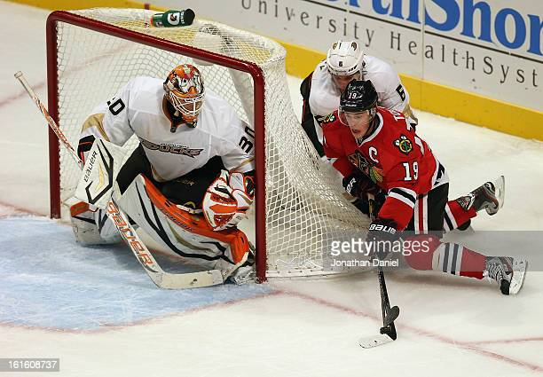 Jonathan Toews of the Chicago Blackhawks is knocked down by Ben Lovejoy of the Anaheim Ducks as he tries to shoot against Viktor Fasth at the United...