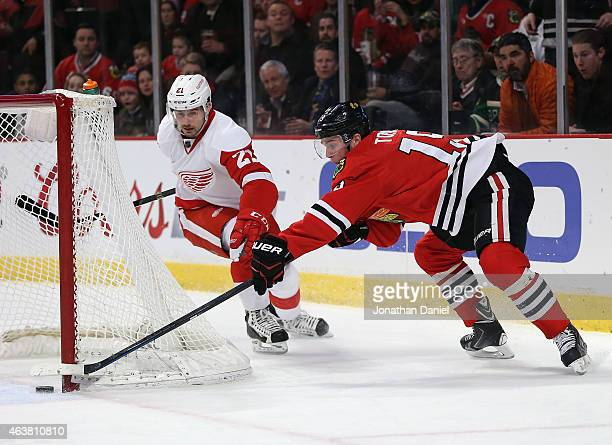 Jonathan Toews of the Chicago Blackhawks just misses a wraparound goal in the second period under pressure from Tomas Tatar of the Detroit Red Wings...