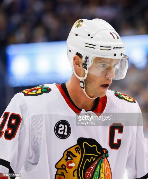 Jonathan Toews of the Chicago Blackhawks looks on during a third period stoppage in play against the Winnipeg Jets at the Bell MTS Place on December...