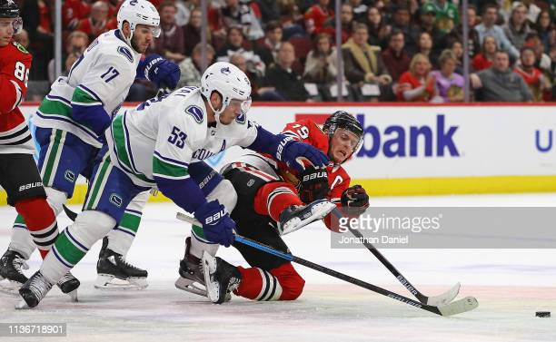 Jonathan Toews of the Chicago Blackhawks looses an overtime faceoff battle with Bo Horvat of the Vancouver Canucks at the United Center on March 18...