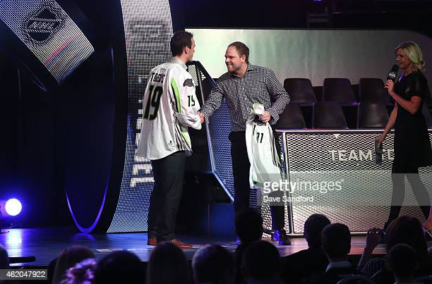 Jonathan Toews of the Chicago Blackhawks of Team Toews shakes the hand of Phil Kessel of the Toronto Maple Leafs after selecting Kessel for Team...