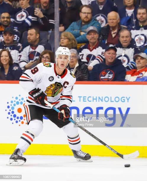 Jonathan Toews of the Chicago Blackhawks plays the puck down the ice during third period action against the Winnipeg Jets at the Bell MTS Place on...