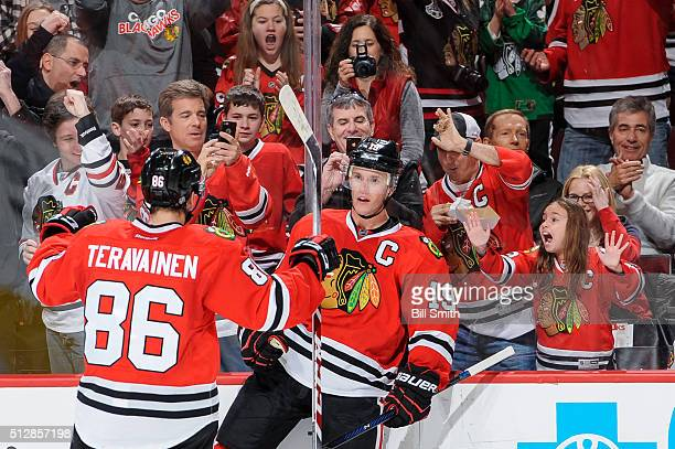 Jonathan Toews of the Chicago Blackhawks reacts after scoring in the second period of the NHL game against the Washington Capitals at the United...