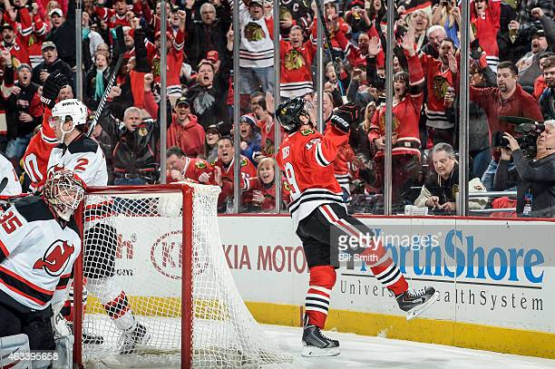 Jonathan Toews of the Chicago Blackhawks reacts after scoring on goalie Cory Schneider of the New Jersey Devils in the third period during the NHL...