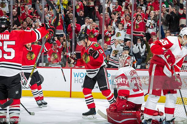 Jonathan Toews of the Chicago Blackhawks reacts after scoring on goalie Jimmy Howard of the Detroit Red Wings in the third period of the NHL game at...