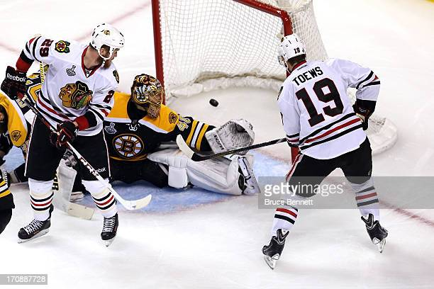 Jonathan Toews of the Chicago Blackhawks scores a goal against Tuukka Rask of the Boston Bruins during the second period in Game Four of the 2013 NHL...