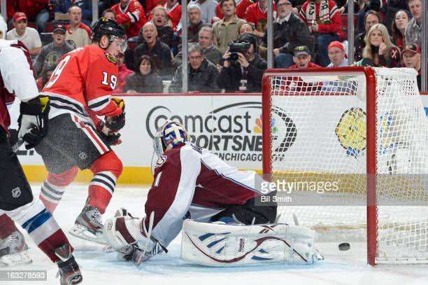 Jonathan Toews of the Chicago Blackhawks scores a goal on goalie Semyon Varlamov of the Colorado Avalanche during the NHL game on March 06, 2013 at...