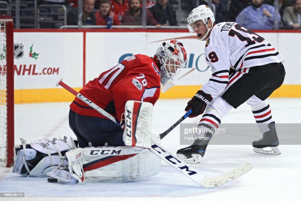 Jonathan Toews #19 of the Chicago Blackhawks scores a goal on goalie Braden Holtby #70 of the Washington Capitals during the third period at Capital One Arena on December 06, 2017 in Washington, DC.