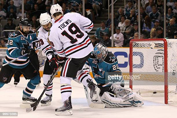 Jonathan Toews of the Chicago Blackhawks scores a second period goal against goaltender Evgeni Nabokov of the San Jose Sharks in Game Two of the...
