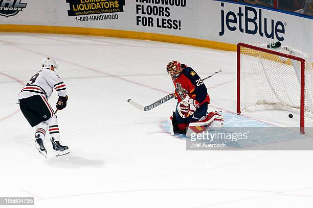 Jonathan Toews of the Chicago Blackhawks scores a shootout goal past goaltender Jacob Markstrom of the Florida Panthers at the BBT Center on October...