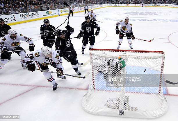 Jonathan Toews of the Chicago Blackhawks scores his second goal in the first period against the Los Angeles Kings in Game Three of the Western...