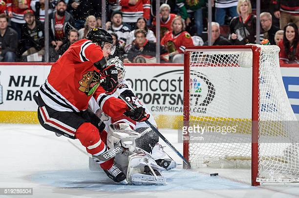 Jonathan Toews of the Chicago Blackhawks scores on goalie Louis Domingue of the Arizona Coyotes in the first period of the NHL game at the United...