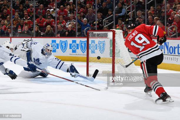 Jonathan Toews of the Chicago Blackhawks scores on goalie Michael Hutchinson of the Toronto Maple Leafs in the first period at the United Center on...