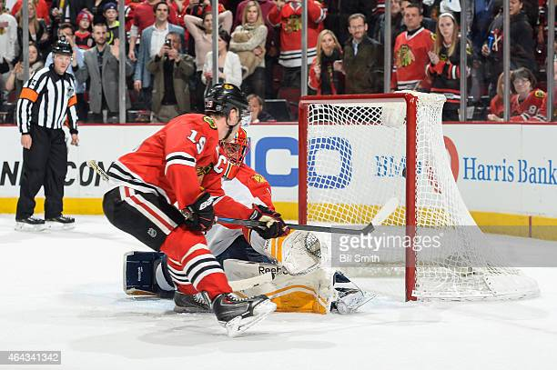 Jonathan Toews of the Chicago Blackhawks scores on the shootout against Roberto Luongo of the Florida Panthers during the NHL game at the United...