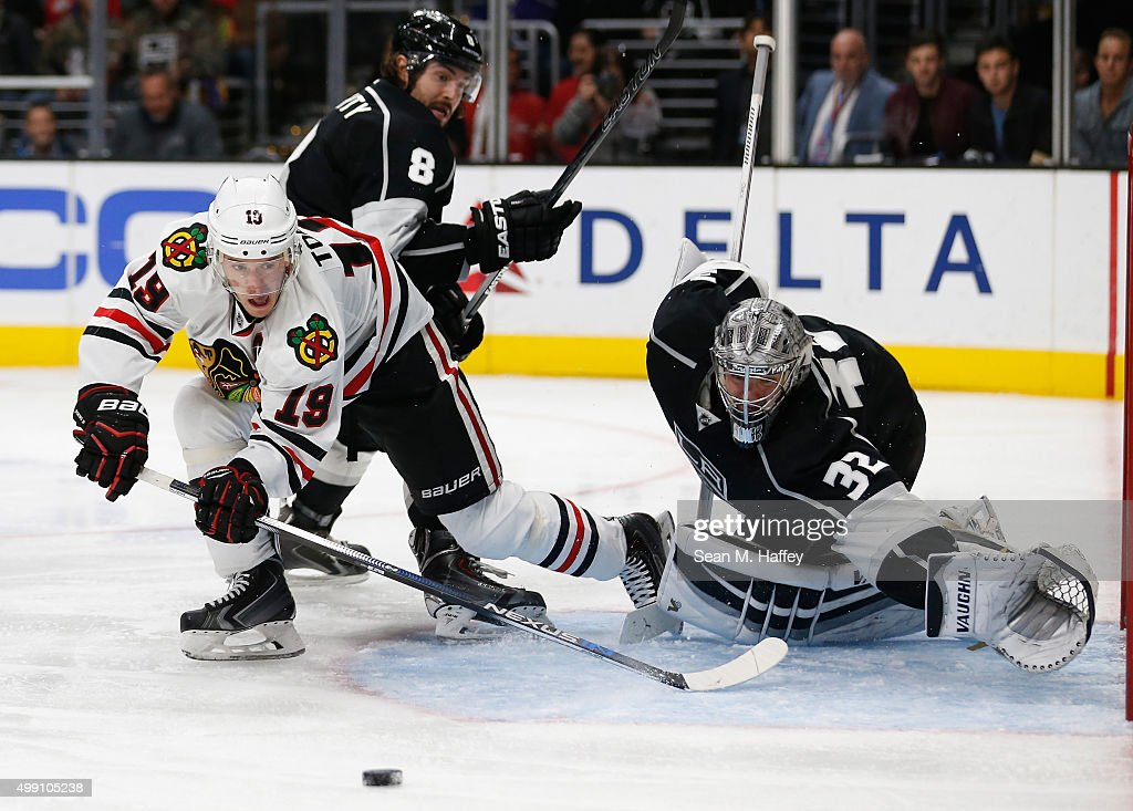 Jonathan Toews #19 of the Chicago Blackhawks shoots a backhand shot at Jonathan Quick #32 of the Los Angeles Kings during the third period of a game at Staples Center on November 28, 2015 in Los Angeles, California.