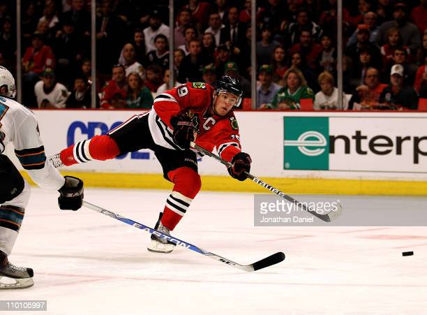 Jonathan Toews of the Chicago Blackhawks shoots the puck for a goal in the second period against the San Jose Sharks at the United Center on March 14...