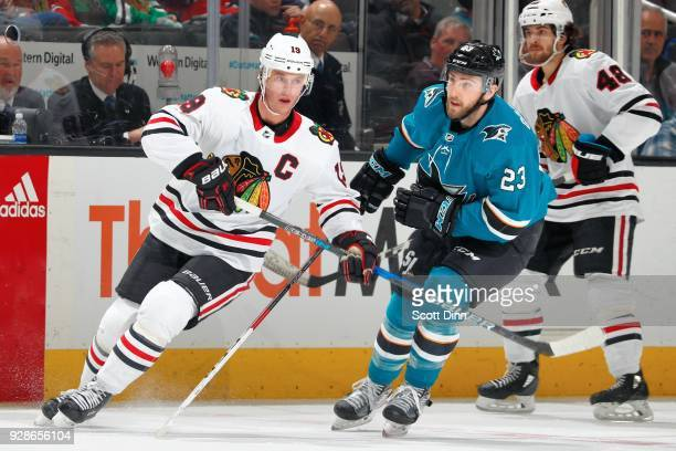 Jonathan Toews of the Chicago Blackhawks skates against Barclay Goodrow of the San Jose Sharks at SAP Center on March 1 2018 in San Jose California