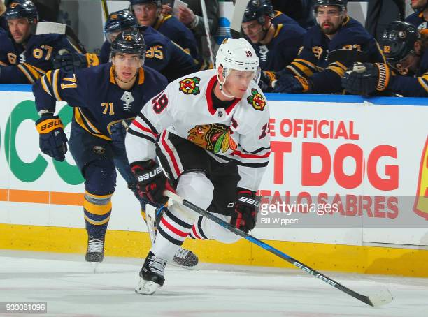 Jonathan Toews of the Chicago Blackhawks skates against Evan Rodrigues of the Buffalo Sabres during an NHL game on March 17 2018 at KeyBank Center in...