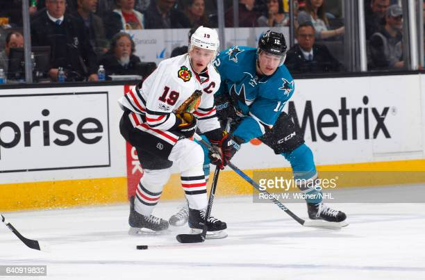 Jonathan Toews of the Chicago Blackhawks skates against Patrick Marleau of the San Jose Sharks at SAP Center on January 31 2017 in San Jose California