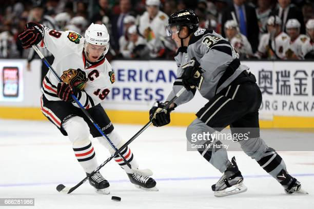 Jonathan Toews of the Chicago Blackhawks skates past Paul LaDue of the Los Angeles Kings during the first period of a game at Staples Center on April...